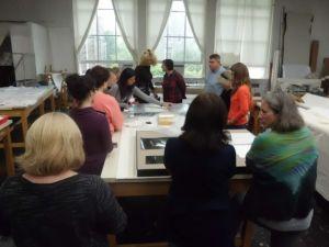 Robin Hodgson (center left) demonstrating the suction table that she custom builds.